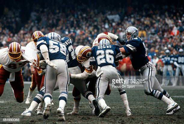 John Dutton Mike Hegman and Michael Downs of the Dallas Cowboys in action against the Washington Redskins during an NFL Football game circa 1982 at...