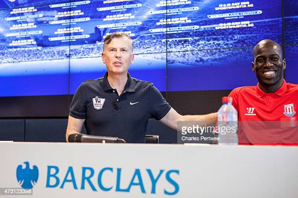 John Dykes football pundit speaks as Mamady Sidibe former Stoke player look on during a QA at the Barclays office during the Barclays Asia Trophy...
