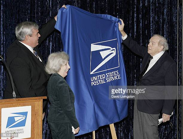 John E Potter Postmaster General and CEO of the US Postal Service Mona Malden and actor Karl Malden unveil the dedication sign during the dedication...