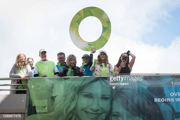John Easterling Olivia NewtonJohn and Tottie Goldsmith cheering the crowd during the annual Wellness Walk and Research Runon September 16 2018 in...