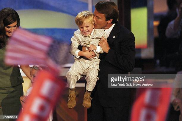 John Edwards gives his giggling son Jack a kiss on the ear after addressing the Democratic National Convention at the FleetCenter in Boston