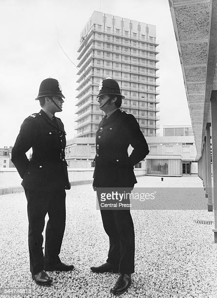 John Edwards of Barrow in Furness, and PC Michael Smythe of Cheltenham, in front of the section house of the new police station complex in Paddington...