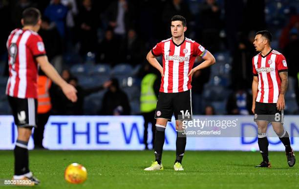 John Egan of Brentford looks dejected after Luke Freeman of Queens Park Rangers scored the 2nd QPR goal during the Sky Bet Championship match between...