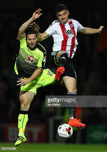 John Egan of Brentford tries to tackle Yann Kermorgant of Reading during the Sky Bet Championship match between Brentford and Reading at Griffin Park...