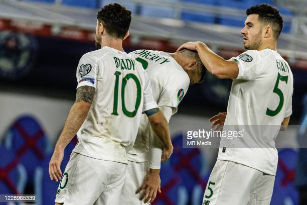 John Egan of Republic of Ireland reacts with Matt Doherty after losing the UEFA EURO 2020 Play-Off Semi-Final match between Slovakia and Republic of...