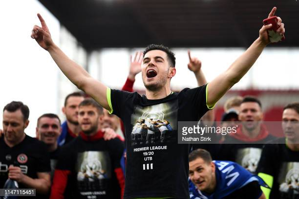 John Egan of Sheffield United and teammates celebrate their promotion after the Sky Bet Championship match between Stoke City and Sheffield United at...