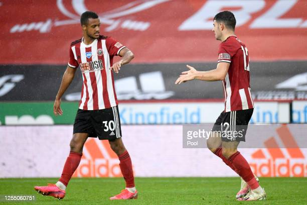 John Egan of Sheffield United celebrates after he scores his sides first goal during the Premier League match between Sheffield United and...