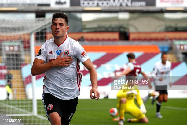 John Egan of Sheffield United celebrates after scoring his team's first goal during the Premier League match between Burnley FC and Sheffield United...