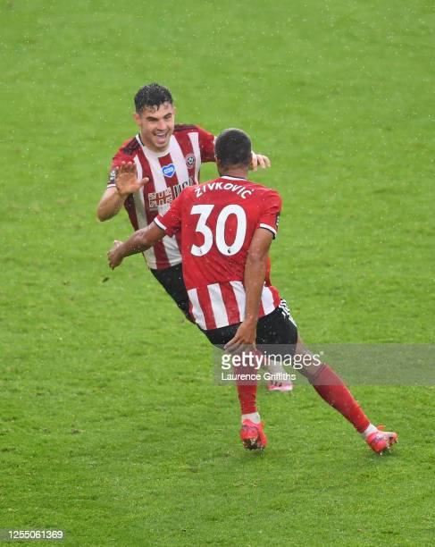 John Egan of Sheffield United celebrates after scoring his teams first goal during the Premier League match between Sheffield United and...