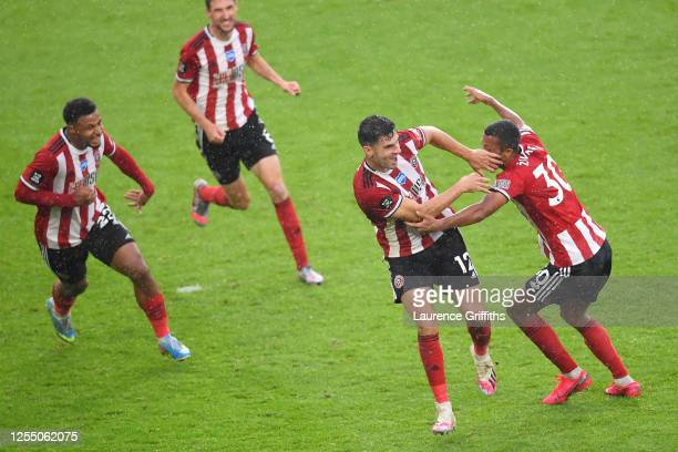 John Egan of Sheffield United celebrates with his team after he scores his sides first goal during the Premier League match between Sheffield United...