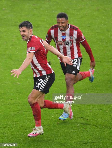 John Egan of Sheffield United celebrates with Lys Mousset after scoring the winning goal during the Premier League match between Sheffield United and...