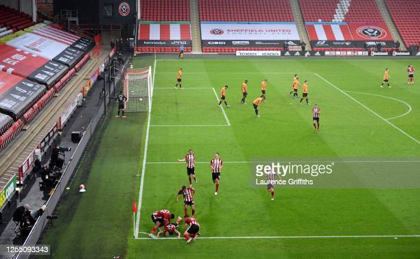 John Egan of Sheffield United celebrates with team mates after scoring the winning goal during the Premier League match between Sheffield United and...