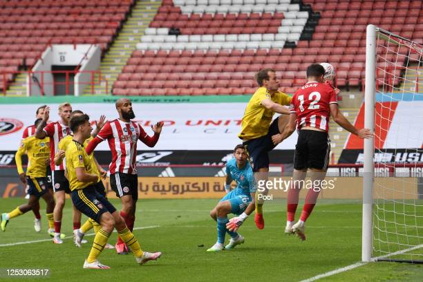 John Egan of Sheffield United heads the ball towards the goal but is disallowed by VAR for being offside during the FA Cup Fifth Quarter Final match...