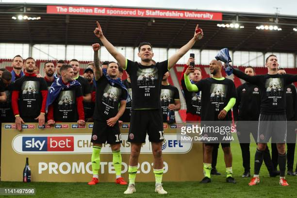 John Egan of Sheffield United leads the chant as Sheffield United players and staff celebrate promotion to the Premier League during the Sky Bet...