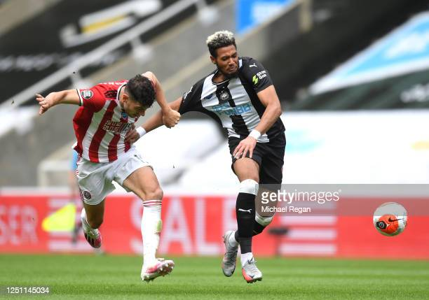 John Egan of Sheffield United pulls the shirt of Joelinton of Newcastle United which leads to the second yellow card for John Egan and him being sent...