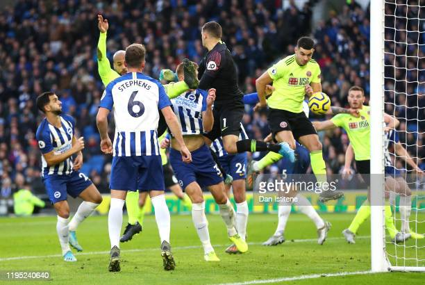 John Egan of Sheffield United scores a goal which is then disallowed following a VAR review during the Premier League match between Brighton Hove...