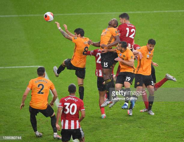 John Egan of Sheffield United scores his sides first goal during the Premier League match between Sheffield United and Wolverhampton Wanderers at...