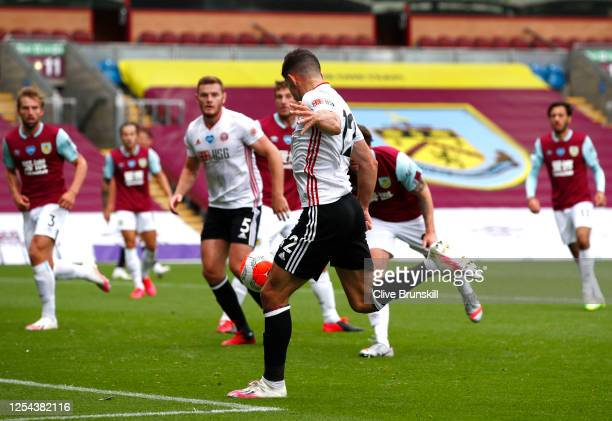 John Egan of Sheffield United scores his team's first goal during the Premier League match between Burnley FC and Sheffield United at Turf Moor on...