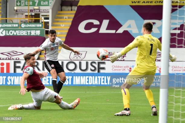 John Egan of Sheffield United scores his team's first goal past Nick Pope of Burnley during the Premier League match between Burnley FC and Sheffield...