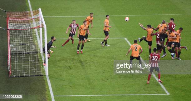 John Egan of Sheffield United scores the winning the winning goal during the Premier League match between Sheffield United and Wolverhampton...