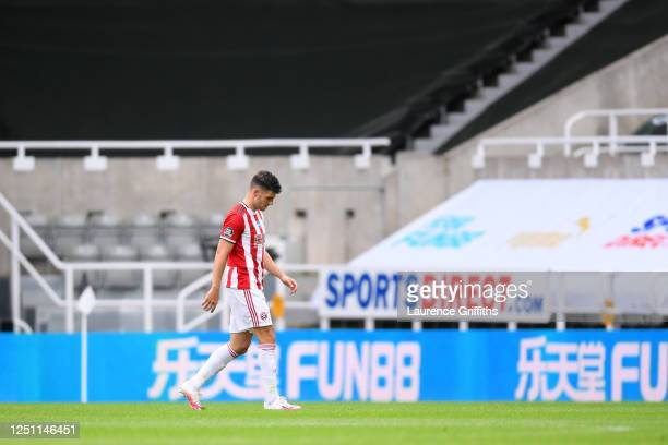 John Egan of Sheffield United walks off after being shown a red card during the Premier League match between Newcastle United and Sheffield United at...