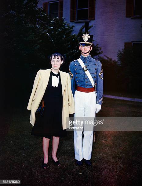 John Eisenhower the son of President Dwight Eisenhower stands with his mother Mamie Eisenhower after he graduated from the United States Military...