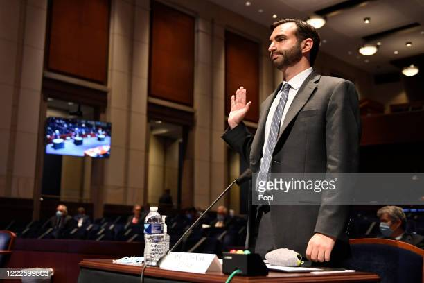 John Elias, a career official in the Justice Department's antitrust division, is sworn in before the House Judiciary Committee for a hearing on...
