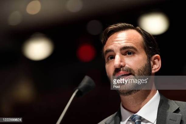 John Elias, a career official in the Justice Department's antitrust division, testifies before the House Judiciary Committee during a hearing on...