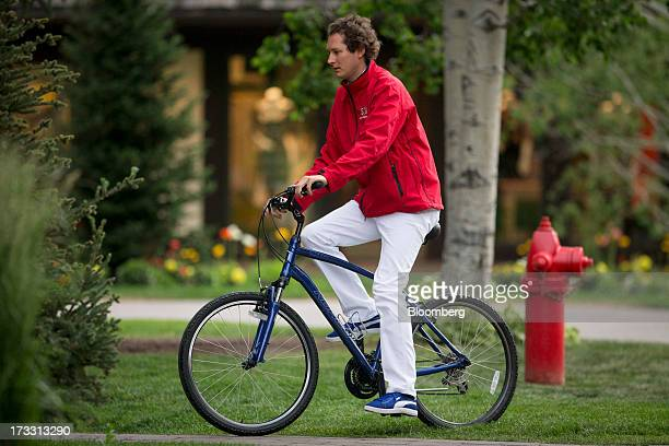 John Elkann chairman of Fiat SpA rides a bicycle to a morning session at the Allen Co Media and Technology Conference in Sun Valley Idaho US on...