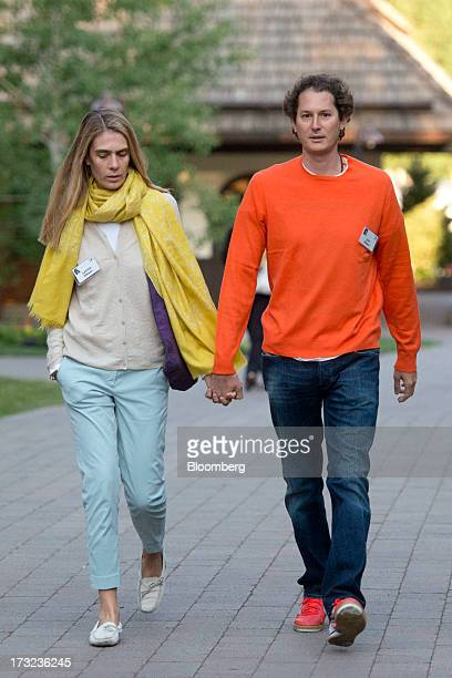 John Elkann chairman of Fiat SpA right holds hands with Lavinia Elkann as they arrive for a morning session during the Allen Co Media and Technology...