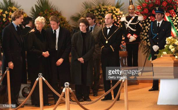 John Elkann Marella Agnelli wife of Giovanni Agnelli Lapo Elkann and other unidentified members of Agnelli's family stand near the coffin of Fiat...