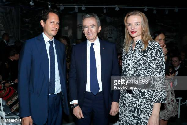 John Elkann, Owner of LVMH Luxury Group Bernard Arnault and Louis Vuitton's executive vice president Delphine Arnault attend the Christian Dior Haute...