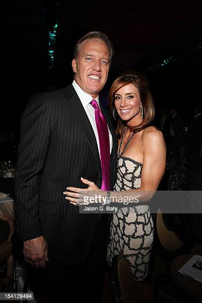John Elway and Paige Green attend the Be Beautiful Be Yourself Fashion Show at Sheraton Downtown Denver Hotel on October 13 2012 in Denver Colorado