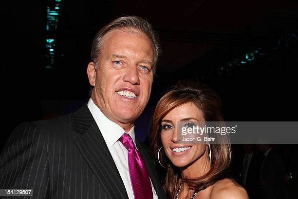 John Elway and wife Paige Green attend the Be Beautiful Be Yourself Fashion Show at Sheraton Downtown Denver Hotel on October 13 2012 in Denver...