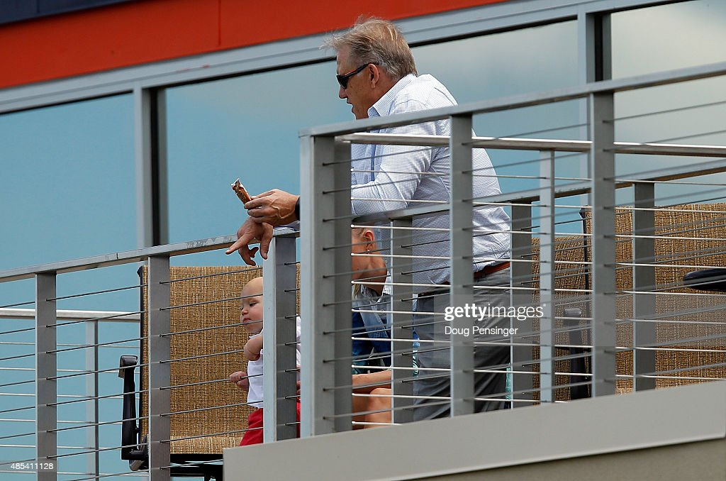 John Elway General Manager and Executive Vice President of Football Operations for the Denver Broncos watches practice during a joint training session with the San Francisco 49ers and the Denver Broncos at the Denver Broncos Training Facility on August 27, 2015 in Englewood, Colorado.