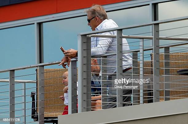 John Elway General Manager and Executive Vice President of Football Operations for the Denver Broncos watches practice during a joint training...