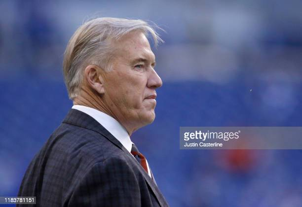 John Elway general manager of the Denver Broncos on the sidelines before the game against the Indianapolis Colts at Lucas Oil Stadium on October 27...