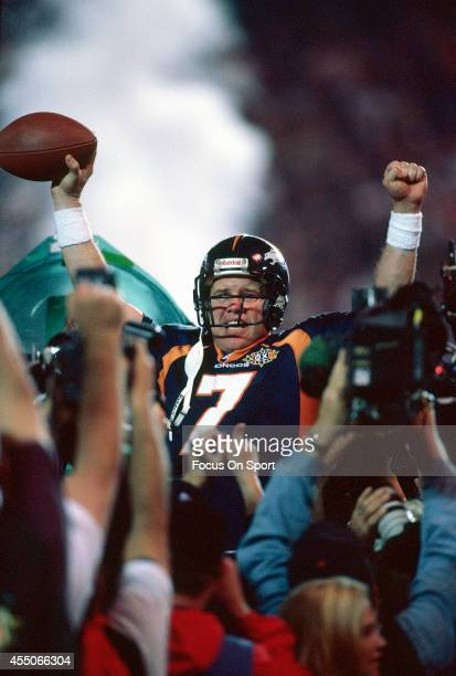 John Elway of the Denver Broncos celebrates defeating the Green Bay Packers in Super Bowl XXXII on January 25 1998 at Qualcomm Stadium in San Diego...