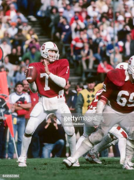 John Elway of the Stanford Cardinal attempts a pass during an NCAA Pac-10 football game against the University of Washington Huskies played on...