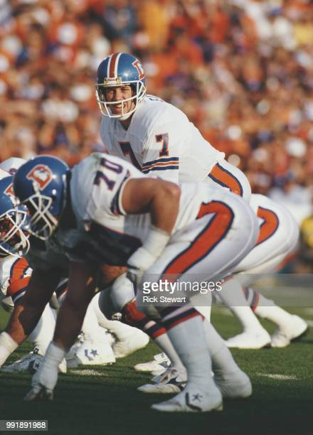 John Elway, Quarterback for the Denver Broncos calls the play on the line of scrimmage during the American Football Conference Championship game...