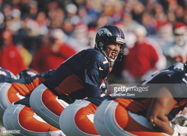 John Elway Quarterback for the Denver Broncos calls the play on the line of scrimmage during the American Football Conference West game against the...