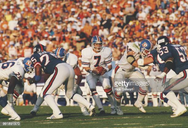 John Elway, Quarterback for the Denver Broncos prepares to hand the ball off during the National Football League Super Bowl XXI game against the...
