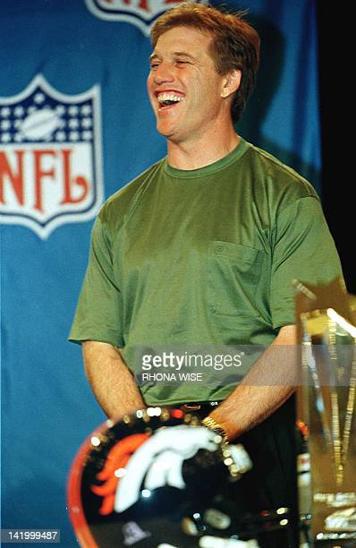 John Elway quarterback of the Denver Broncos and Super Bowl XXXIII MVP laughs at his introduction by NFL commissioner Paul Tagliabue as he waits to...