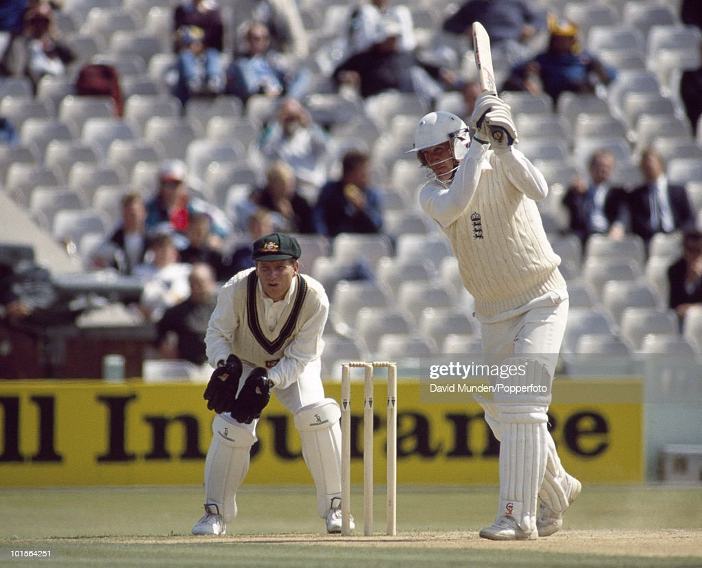 John Emburey batting for England on the fifth day of the 4th Test match between England and Australia at Old Trafford in Manchester, 1st August 1989. Emburey scored 64 runs in 220 minutes. The Australian wicketkeeper is Ian Healy. Australia won by 9 wickets.