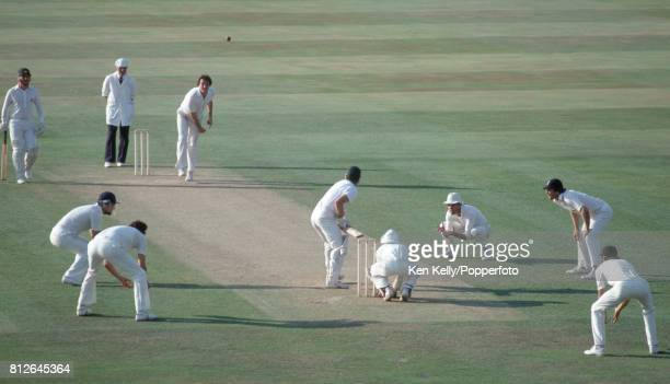 John Emburey of England bowls to Australian batsman Dirk Wellham towards the end of the 1st day of the 6th Test match between England and Australia...