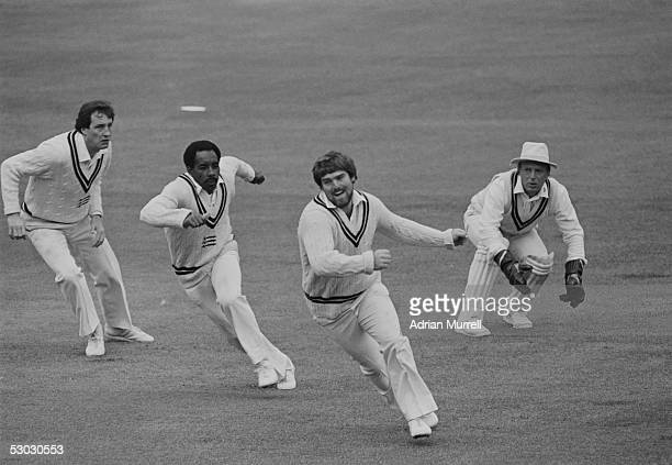 John Emburey Roland Butcher Mike Gatting and wicket keeper Paul Downton of Middlesex in action during the Britannic Assurance County Championship...
