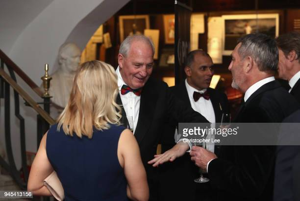 John Emburey talks to Katherine Brunt and Graham Gooch during the PCA Long Room Dinner at Lord's Cricket Ground on April 12, 2018 in London, England.