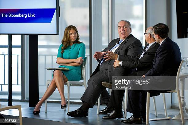 John Engler former governor of Michigan and president of the Business Roundtable second from left speaks as Trish Regan Bloomberg Television reporter...