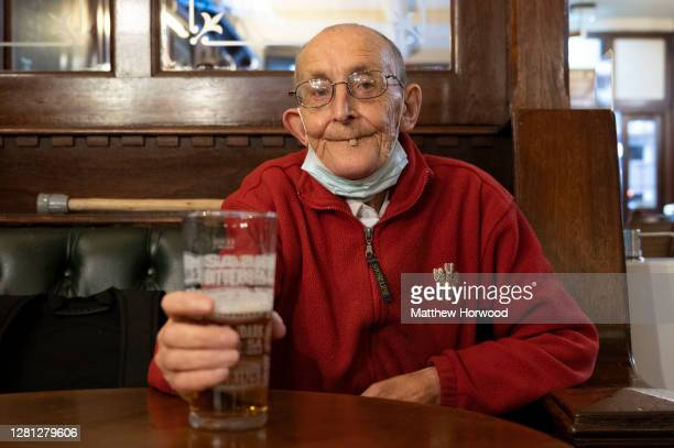 John enjoys a pint in the Goat Major pub on October 20, 2020 in Cardiff, Wales. Wales will go into a national lockdown from Friday until November 9....