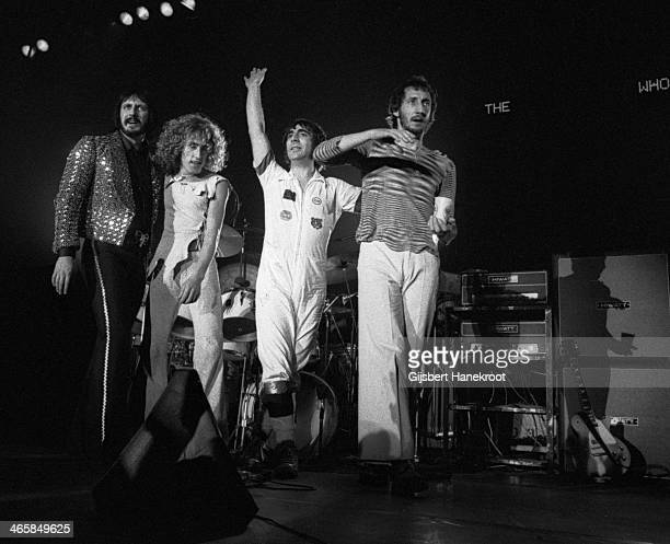 John Entwistle Roger Daltrey Keith Moon and Pete Townshend of The Who line up at the front of the stage at the end of a concert at Ahoy in Rotterdam...